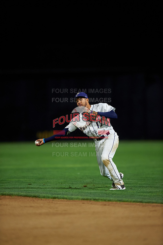 Tri-City Dust Devils second baseman Reinaldo Ilarraza (12) throws to first base during a Northwest League game against the Vancouver Canadians at Gesa Stadium on August 21, 2019 in Pasco, Washington. Vancouver defeated Tri-City 1-0. (Zachary Lucy/Four Seam Images)