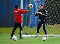 Pictured L-R: Goalkeeping Coach Adrian Tucker with goalkeeper Jose Moreira. Thursday 05 April 2012<br />