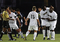 Aaron Maund #2 of the University of Notre Dame congratulates Bright Dike #9 after Dike scored his first of three goals against the University of Michigan during a men's NCAA match at the new Alumni Stadium on September 1 2009 in South Bend, Indiana. Notre Dame won 5-0.