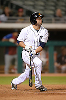 Mesa Solar Sox outfielder Tyler Collins (4), of the Detroit Tigers organization, hits his teams third home run of the inning during an Arizona Fall League game against the Peoria Javelinas on October 17, 2013 at HoHoKam Park in Mesa, Arizona.  Mesa defeated Peoria 6-1.  (Mike Janes/Four Seam Images)