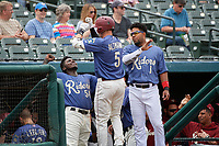Frisco RoughRiders Josh Altman (5) celebrates hitting a home run with Michael De Leon (54) and Elvis Andrus (1) during a Texas League game against the Midland RockHounds on May 21, 2019 at Dr Pepper Ballpark in Frisco, Texas.  (Mike Augustin/Four Seam Images)