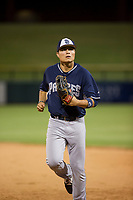 AZL Padres center fielder Tirso Ornelas (33) jogs off the field between innings of the game against the AZL Cubs on August 28, 2017 at Sloan Park in Mesa, Arizona. AZL Cubs defeated the AZL Padres 2 9-4. (Zachary Lucy/Four Seam Images)