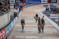 Sonny Colbrelli (ITA/Bahrain-Victorius) wins the sprint against Florian Vermeersch (BEL/Lotto Soudal) and Mathieu van der Poel (NED/Alpecin Fenix)   inside the famous velodrome. <br /> <br /> 118th Paris-Roubaix 2021 (1.UWT)<br /> One day race from Compiègne to Roubaix (FRA) (257.7km)<br /> <br /> ©kramon