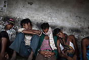 Tired workers of the Jindal Power plant are seen taking a nap outside the plant in Tamnar, the outskirts of Raigarh, Chhattisgarh, India. Photograph: Sanjit Das/Panos for Bloomberg Businessweek