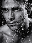 Dramatic closeup portrait of a man face wet from water pouring on it. Black and white. Image © MaximImages, License at https://www.maximimages.com