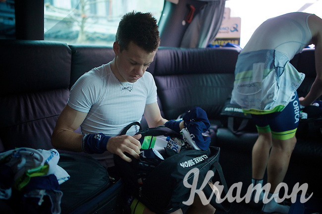 Simon Clarke (AUS/Orica-GreenEDGE) getting some stuff out of his rainbag as it promises to be a dreary day<br /> <br /> 101th Liège-Bastogne-Liège 2015