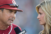 Oklahoma's Coach Sunny Golloway in interviewed by ESPNs Erin Andrews in Game 10 of the NCAA Division One Men's College World Series on June 24th, 2010 at Johnny Rosenblatt Stadium in Omaha, Nebraska.  (Photo by Andrew Woolley / Four Seam Images)