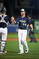 Vermont Lake Monsters pitcher Andrew Tomasovich (44) shakes hands with catcher Tom Gavitt (5) after closing out a game against the Hudson Valley Renegades on September 3, 2015 at Centennial Field in Burlington, Vermont.  Vermont defeated Hudson Valley 4-1.  (Mike Janes/Four Seam Images)