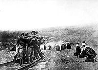 Austri'a Atrocities.  Blindfolded and in a kneeling position, patriotic Jugo-Slavs in Serbia near the Austrian lines were arranged in a semi-circle and ruthlessly shot at a command.  Underwood & Underwood.  (War Dept.)<br /> EXACT DATE SHOT UNKNOWN<br /> NARA FILE #:  165-WW-179A-8<br /> WAR & CONFLICT BOOK #:  691