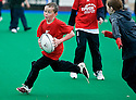 PUPILS FROM DEAN PARK (RED) AND CORSTORPHINE PRIMARY SCHOOLS TAKE PART IN THE TOUCH WORLD CUP YOUTH FESTIVAL AT PEFFERMILL.
