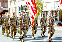 Marc Hayot/Herald Leader Members of the Arkansas National Guard display the colors as they are marching down Broadway during the 2019 Veterans Day Parade.