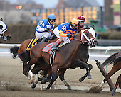 Gotham betting favorite Overanalyze (11) gets the better of the early going as Transparent (maroon) and Siete de Oros (6) get pinched at the clubhouse turn.