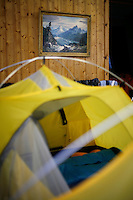 A painting of large mountains hangs on a wall where participants in World BASE Race sleeps. World BASE Race held in Innfjorden, Norway, where BASE jumpers in wingsuits compete in flying down the mountain. The winner is called the World's Fastest Flying Human Being..© Fredrik Naumann/Felix Features