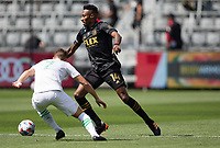 LOS ANGELES, CA - APRIL 17: Mark-Anthony Kaye #14 of LAFC moves with the ball during a game between Austin FC and Los Angeles FC at Banc of California Stadium on April 17, 2021 in Los Angeles, California.