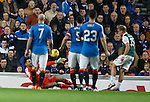 Jason Cummings beats the onrushing Wes Foderingham in goals to score for Hibs