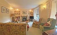 BNPS.co.uk (01202 558833)<br /> Pic: LillicrapChilcott/BNPS<br /> <br /> Pictured: The farmhouse sitting room.<br /> <br /> A sprawling waterfront estate that has been in the same family for half a century is on the market for £2.25m.<br /> <br /> Bellscat Farmhouse is a pretty Grade II listed home with beautiful far-reaching views over Fowey River in Cornwall.<br /> <br /> The grand four-bedroom home looks a far cry from a typical farmhouse and is believed to have been two farm cottages that were converted into one home.<br /> <br /> There is also a separate two-bedroom barn and the properties sit in 37 acres of undulating land, creating a private and scenic estate.