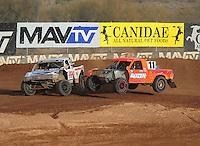 Dec. 11, 2011; Chandler, AZ, USA;  LOORRS pro 2 driver Carl Renezeder (17) and Adrian Cenni (11) get together during the Lucas Oil Challenge Cup at Firebird International Raceway. Mandatory Credit: Mark J. Rebilas-
