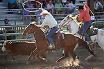 Clint Allegre and Tyson Torvick compete in the double mugging event at the Minden Ranch Rodeo on Saturday, July 23, 2011, in Gardnerville, Nev. .Photo by Cathleen Allison