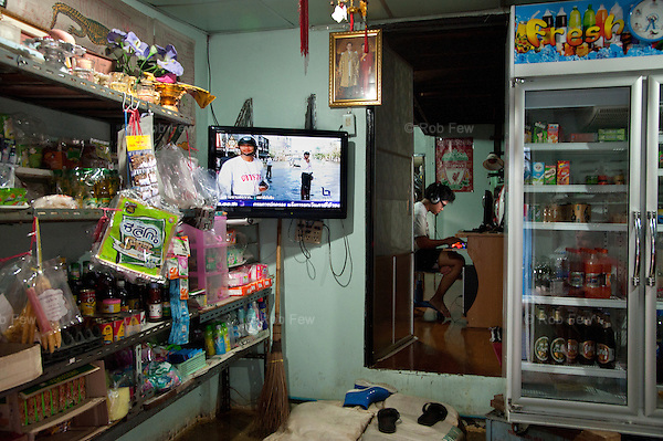 A man uses his computer in his flooded house in western Bangkok.<br /> <br /> Thailand's worst floods for 50 years finally reached the suburbs of Bangkok in October 2011. While the government dithered and argued with itself, more than 200 people died.