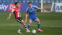 Ryan Bowman of Exeter City passes the ball forward as Gillingham's Robbie McKenzie looks on during Gillingham vs Exeter City, Emirates FA Cup Football at the MEMS Priestfield Stadium on 28th November 2020