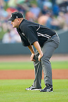Tyler Wilson handles the umpiring duties on the bases during a Carolina League game between the Lynchburg Hillcats and the Winston-Salem Dash at  BB&T Ballpark May 22, 2010, in Winston-Salem, North Carolina.  Photo by Brian Westerholt / Four Seam Images