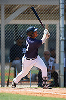 GCL Tigers East third baseman Moises Bello (13) follows through on a swing during a game against the GCL Tigers West on August 8, 2018 at Tigertown in Lakeland, Florida.  GCL Tigers East defeated GCL Tigers West 3-1.  (Mike Janes/Four Seam Images)