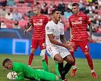 14th September 2021; Sevilla, Spain: UEFA Champions League football, Sevilla FC versus RB Salzburg; Erik Lamela of Sevilla  as the through ball is collected by the goalkeeper Köhn of Salzburg