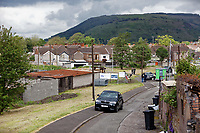 Pictured: The row of garages in Port Talbot. Tuesday 28 May 2019<br /> Re: Contractors are working to move Banksy's Season Greeting, now owned by John Brandler, which appeared on a garage wall in Port Talbot, to a new location in the same town in south Wales, UK.