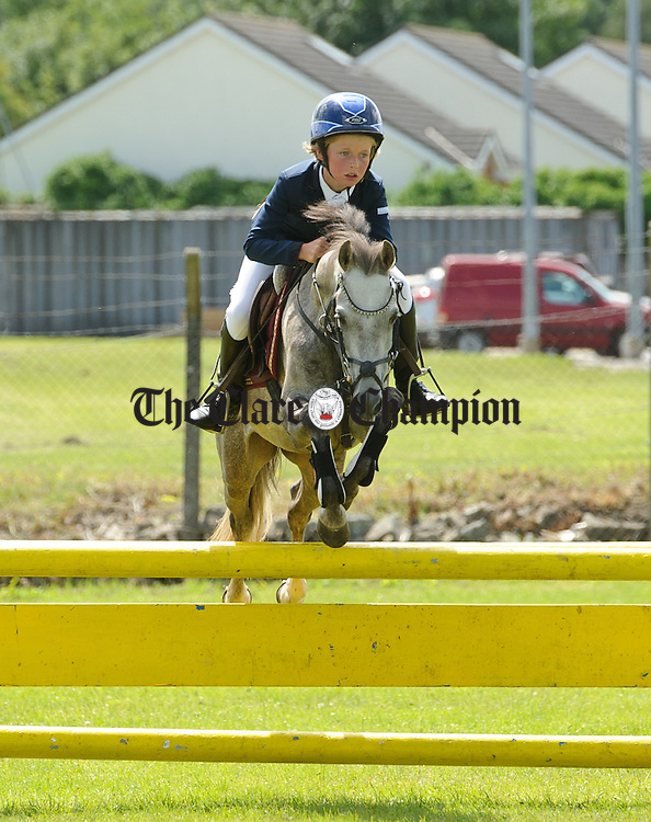 Rhys Williams goes up and over at the Clare County Show in Ennis. Photograph by John Kelly.