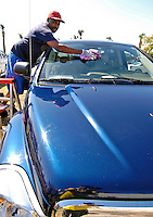 8 March 2007: Behind the scenes at Space Coast Stadium, Randy washes pitcher Chris Michalak's car  prior to a game against the Houston Astros in Viera, Florida. <br /> <br /> Mandatory Photo Credit: Ed Wolfstein Photo