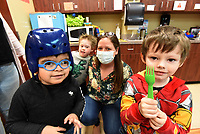 Sarah Pollack, in charge of philanthropy, plays with students on Wednesday March 17 2021 at the Benton County Sunshine School and Development Center in Rogers.<br />