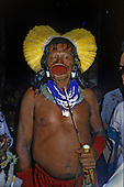 Brazil. Chief Raoni of the Megranoti (Kayapo Nation) with botoque, feather cocar headdress, beads and spear.
