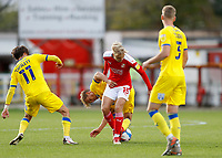 10th October 2020; The County Ground, Swindon, Wiltshire, England; English Football League One; Swindon Town versus AFC Wimbledon; Matthew Smith of Swindon Town being challenged by Jaakko Oksanen and Ethan Chislett of AFC Wimbledon