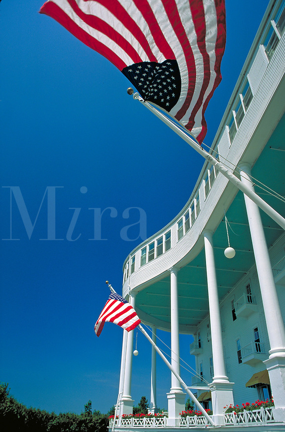 American flags along the world's longest porch, flags. Mackinac Island Michigan USA.