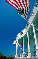 American flags along the world's longest porch, flags. Mackinac Island Michigan USA.