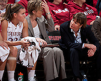 STANFORD, CA - January 8, 2011: Jeanette Pohlen, Assistant Coach Kate Paye and Coach Tara VanDerveer of the Stanford Cardinal women's basketball team during Stanford's game against Arizona State at Maples Pavilion. Stanford won 82-35.