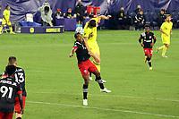 NASHVILLE, TN - SEPTEMBER 23: Ola Kamara #9 of DC United and Dave Romney #4 of Nashville SC challenge for a header during a game between D.C. United and Nashville SC at Nissan Stadium on September 23, 2020 in Nashville, Tennessee.