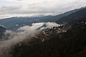 A small village is seen nestled in the mountains on the way to Thimphu, Bhutan