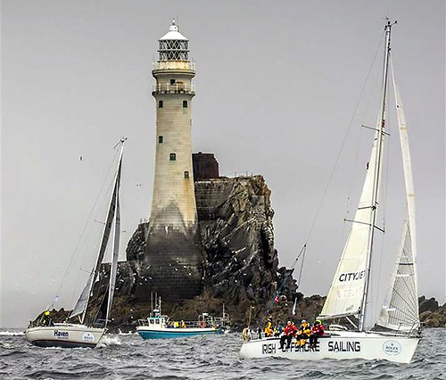 Irish offshore Sailing's Desert Star at the Fastnet Rock, on the way to winning the Roger Justice Trophy.