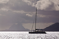 Yacht in lagoon with Bora Bora in background