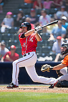 Blake Miller (21) of the Richmond Flying Squirrels follows through on his swing against the Bowie Baysox at The Diamond on May 24, 2015 in Richmond, Virginia.  The Flying Squirrels defeated the Baysox 5-2.  (Brian Westerholt/Four Seam Images)