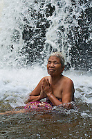 Women worship in the river at Phnom Kulen a sacred site for the Khmer people