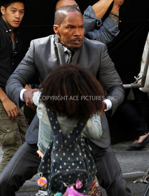WWW.ACEPIXS.COM<br /> <br /> September 25 2013, New York City<br /> <br /> Actors Jamie Foxx and Quvenzhané Wallis on the set of the new movie 'Annie' on September 25 2013 in New York City<br /> <br /> By Line: Zelig Shaul/ACE Pictures<br /> <br /> <br /> ACE Pictures, Inc.<br /> tel: 646 769 0430<br /> Email: info@acepixs.com<br /> www.acepixs.com