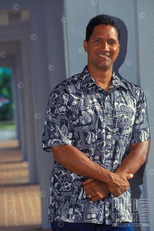 Part Hawaiian business man in Aloha shirt outside office building