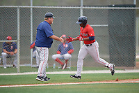 Boston Red Sox manager Joe Oliver congratulates Kyri Washington (35) as he rounds third base after hitting a home run during a minor league Spring Training intrasquad game on March 31, 2017 at JetBlue Park in Fort Myers, Florida. (Mike Janes/Four Seam Images)