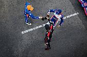 #10: Alex Palou, Chip Ganassi Racing Honda celebrates winning the Honda Indy Grand Prix of Alabama, #9: Scott Dixon, Chip Ganassi Racing Honda, #12: Will Power, Team Penske Chevrolet, champagne
