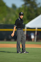 Umpire Kaz Endo handles the calls on the bases during the Appalachian League game between the Bluefield Blue Jays and the Burlington Royals at Burlington Athletic Park on June 29, 2015 in Burlington, North Carolina.  The Royals defeated the Blue Jays 4-1. (Brian Westerholt/Four Seam Images)