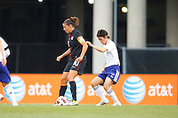 14 MAY 2011: USA Women's National Team midfielder Carli Lloyd (10) shields the ball from Japan National team Yukari King during the International Friendly soccer match between Japan WNT vs USA WNT at Crew Stadium in Columbus, Ohio.