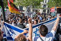 """Anlaesslich des sog. """"Al Quds-Marsch"""" protestierten am Samstag den 1. Juni in Berlin hundete Menschen unter dem Motto """"Kein Islamismus und Antisemitismus in Berlin – Gegen den Quds-Marsch"""".<br /> Zum Ende des islamischen Fastenmonats Ramadan marschieren radikale Islamisten, Anhaenger der Hisbollah und der Diktatur im Iran durch Berlin und rufen zum Kampf gegen Israel auf. Sie rufen dazu auf, die Juden aus Jerusalem (Quds) zu vetreiben und wollen Israel vernichten. Der """"Quds-Tag"""" wurde 1979 vom iranischen Revolutionsfuehrer Ayatollah Khomeini als politischer Kampftag etabliert, an dem weltweit fuer die Vernichtung Israels geworben wird.<br /> Zu dem Protest gegen den antisemitschen Aufmarsch riefen u.a. der DGB Berlin-Brandenburg, die Deutsch-Israelische Gesellschaft Berlin-Brandenburg, das  Juedische Forum fuer Demokratie und gegen Antisemitismus, die Juedische Gemeinde zu Berlin, der Lesben- und Schwulenverband Deutschland (LSVD) Berlin-Brandenburg und die Kurdische Gemeinde Deutschland auf. """"Wir demonstrieren für Solidaritaet mit Israel und protestieren gegen jede Form von antisemitischer und islamistischer Propaganda in Berlin.""""<br /> Im Bild: Sog. """"Antideutschen Gegendemonstranten gelang es an die Demonstrationsstrecke zu kommen, die Polizei trennte beide Seiten.<br /> 1.6.2019, Berlin<br /> Copyright: Christian-Ditsch.de<br /> [Inhaltsveraendernde Manipulation des Fotos nur nach ausdruecklicher Genehmigung des Fotografen. Vereinbarungen ueber Abtretung von Persoenlichkeitsrechten/Model Release der abgebildeten Person/Personen liegen nicht vor. NO MODEL RELEASE! Nur fuer Redaktionelle Zwecke. Don't publish without copyright Christian-Ditsch.de, Veroeffentlichung nur mit Fotografennennung, sowie gegen Honorar, MwSt. und Beleg. Konto: I N G - D i B a, IBAN DE58500105175400192269, BIC INGDDEFFXXX, Kontakt: post@christian-ditsch.de<br /> Bei der Bearbeitung der Dateiinformationen darf die Urheberkennzeichnung in den EXIF- und  IPTC-Daten nicht entfernt werden, diese"""