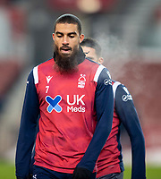 29th December 2020; Bet365 Stadium, Stoke, Staffordshire, England; English Football League Championship Football, Stoke City versus Nottingham Forest; Steam comes from Lewis Grabban of Nottingham Forest during the warm up